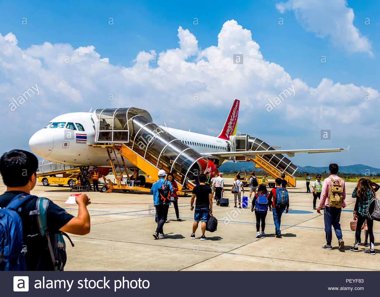 A Vietjet loading in DaLat Airport with passengers walking to the plane. Editorial, March 2, 2018, passengers walking. - Stock Image