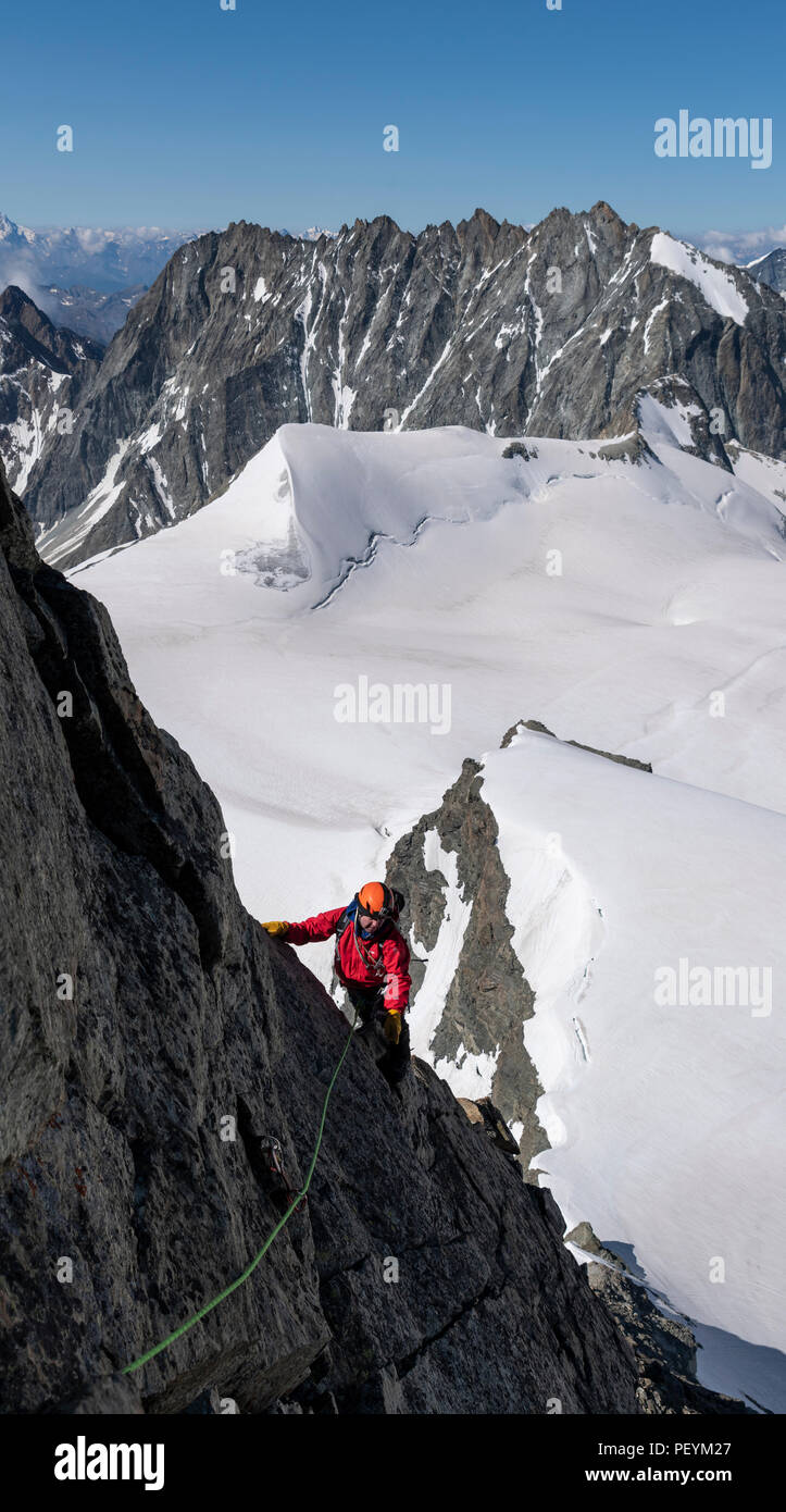 A climber on the South East ridge of L'Eveque in the Valais Alps Stock Photo