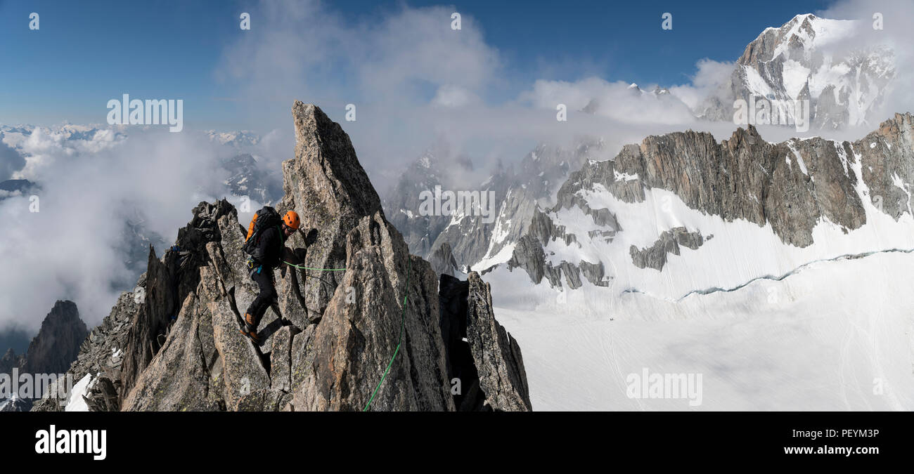 A climber on the traverse of the Aiguille d'Entrees Stock Photo