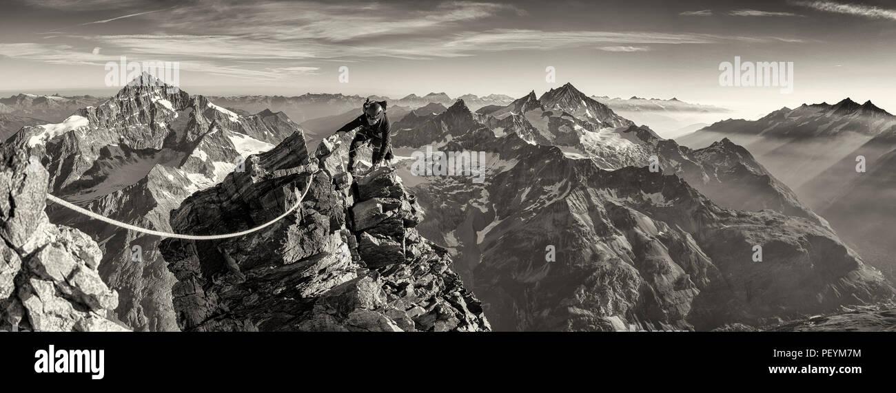 A climber on the Hornli Ridge of the Matterhorn Stock Photo