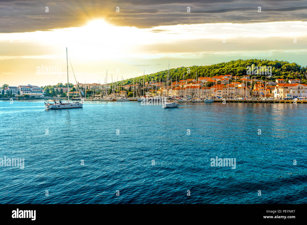 Boats in the harbor of the Croatian coastal city of Hvar, one of the many Islands near Dubrovnik and Korcula on the Dalmatian Coast of Croatia - Stock Image