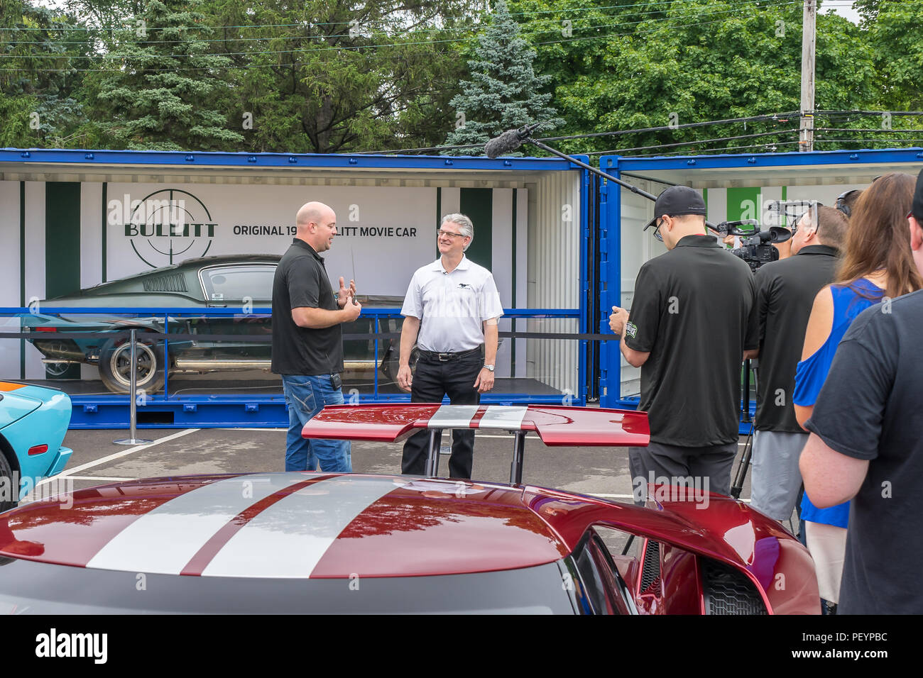 ROYAL OAK, MI/USA - AUGUST 17, 2018: Carl Widman, Chief Engineer, owner Sean Kiernan, original 1968 Ford Bullitt Mustang driven by Steve McQueen. - Stock Image