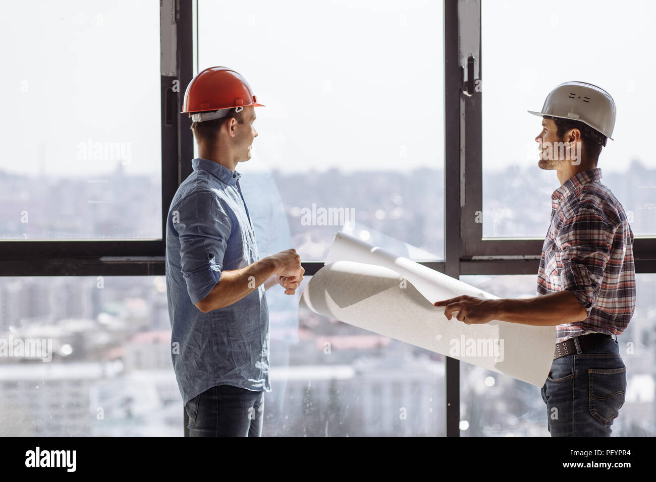 two experiences architects are planning a work skedule. side view photo - Stock Image
