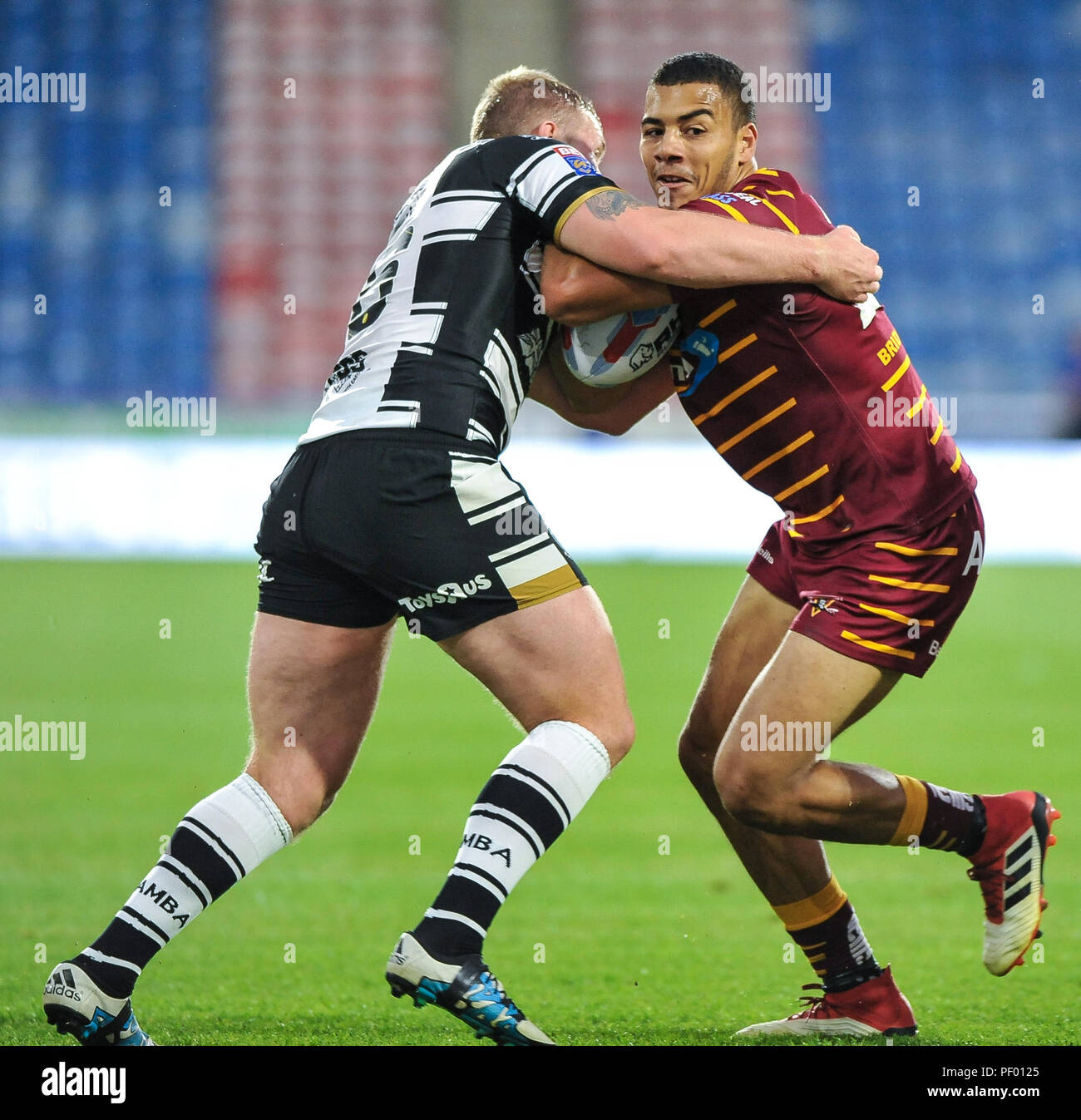 Huddersfield, UK. 17th August 2018.  Rugby League Super 8's match between Huddersfield Giants vs Hull FC. ; Darnell Macintosh of Huddersfield Giants is stopped by Hull FC's Fetuli Talanoa at the  John Smiths Stadium, Huddersfield, UK.  Dean Williams Credit: Dean Williams/Alamy Live News Credit: Dean Williams/Alamy Live News Stock Photo