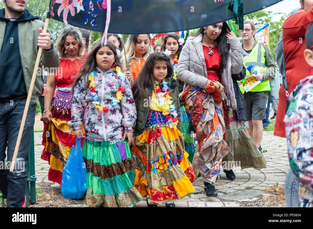 Glasgow, Scotland, UK. 18th August, 2018. Women and girls from the Roma Community at the start of the parade of the Govanhill International Festival & Carnival. This year's parade includes community groups, a pipe band, drummers, dancers, jugglers, roller skaters and a brass band all starting at Govanhill Park and travelling through the streets of Govanhill finishing at the Queen's Park Arena. Credit: Skully/Alamy Live News - Stock Image