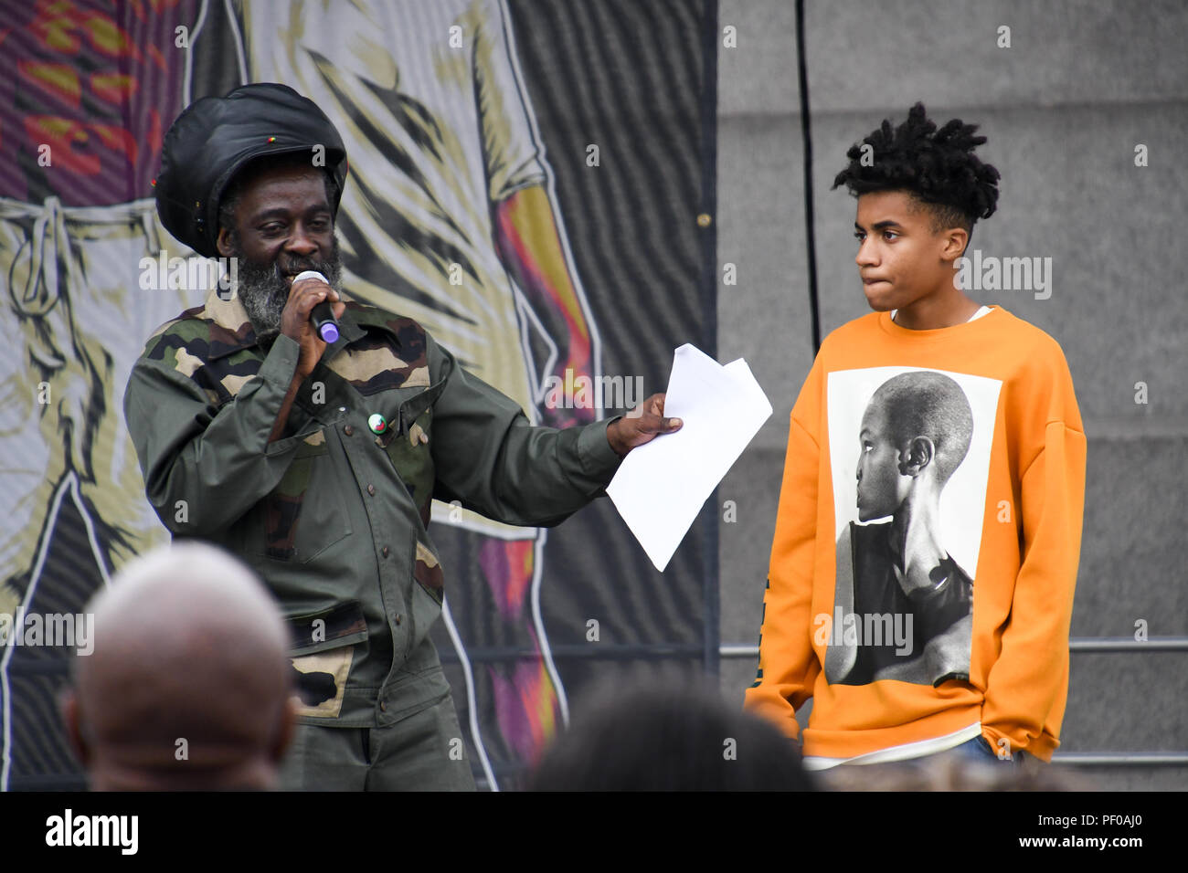 Trafalgar Square, London, England, UK. 18th August 2018. Hundreds of Africans descendant attend the African Holocaust National Memorial - #TimeToRemember2018 My Tribe organizes for the victims of the Transatlantic Slave Trade/African Holocaust. The wound hasn't healed, the nightmare arises repeated of the imperialism and fascist rising in racist attacks in the UK and globally. Credit: Picture Capital/Alamy Live News - Stock Image