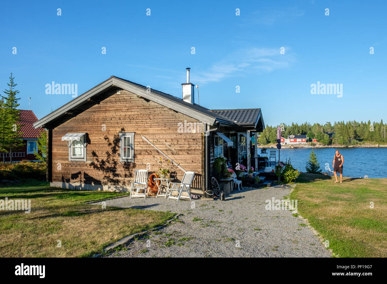 Summer day at Sundsviken outside Lovanger in northern Sweden. This is a popular area for summer cottages in county Vasterbotten. - Stock Image