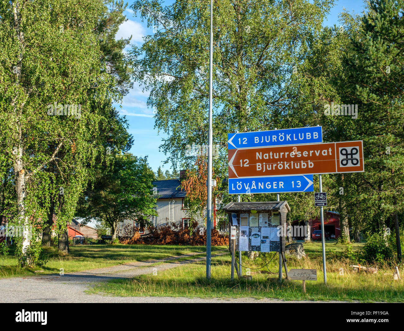Road signs giving directions to Bjuroklubb outside Lovanger in county Vasterbotten in northern Sweden - Stock Image