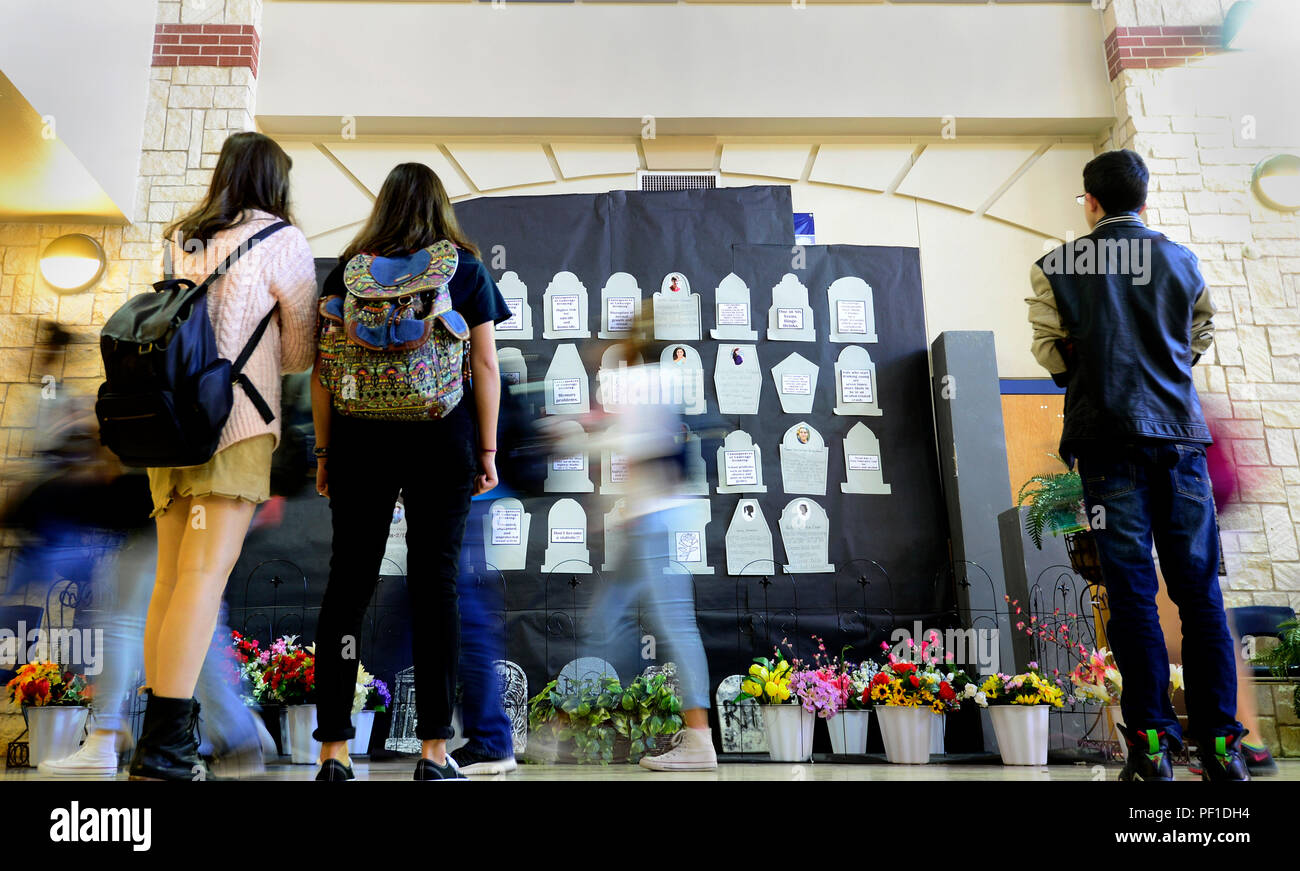 Johnson High School students observe the mock headstone display of simulated casualties during the Johnson HS Shattered Dreams event, San Antonio, Feb. 17, 2016. Every 15 minutes a Johnson High School student was taken from their class to represent a drunk driving casualty. Shattered Dreams is an educational program designed to prevent problems resulting from drinking while driving. Fellow students portray the victims and visually engage their peers to consider the gravity of the issue, and promote responsible decision making. Volunteers from Joint Base San Antonio-Lackland, Wilford Hall Ambul - Stock Image