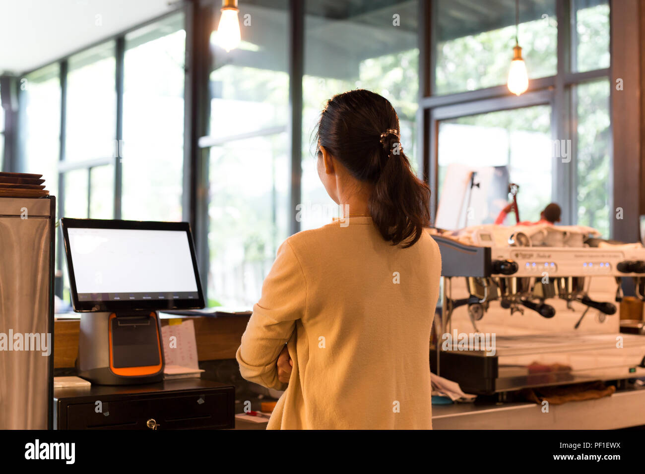 Coffee Business owner Concept young barista standing in a bar in - Stock Image