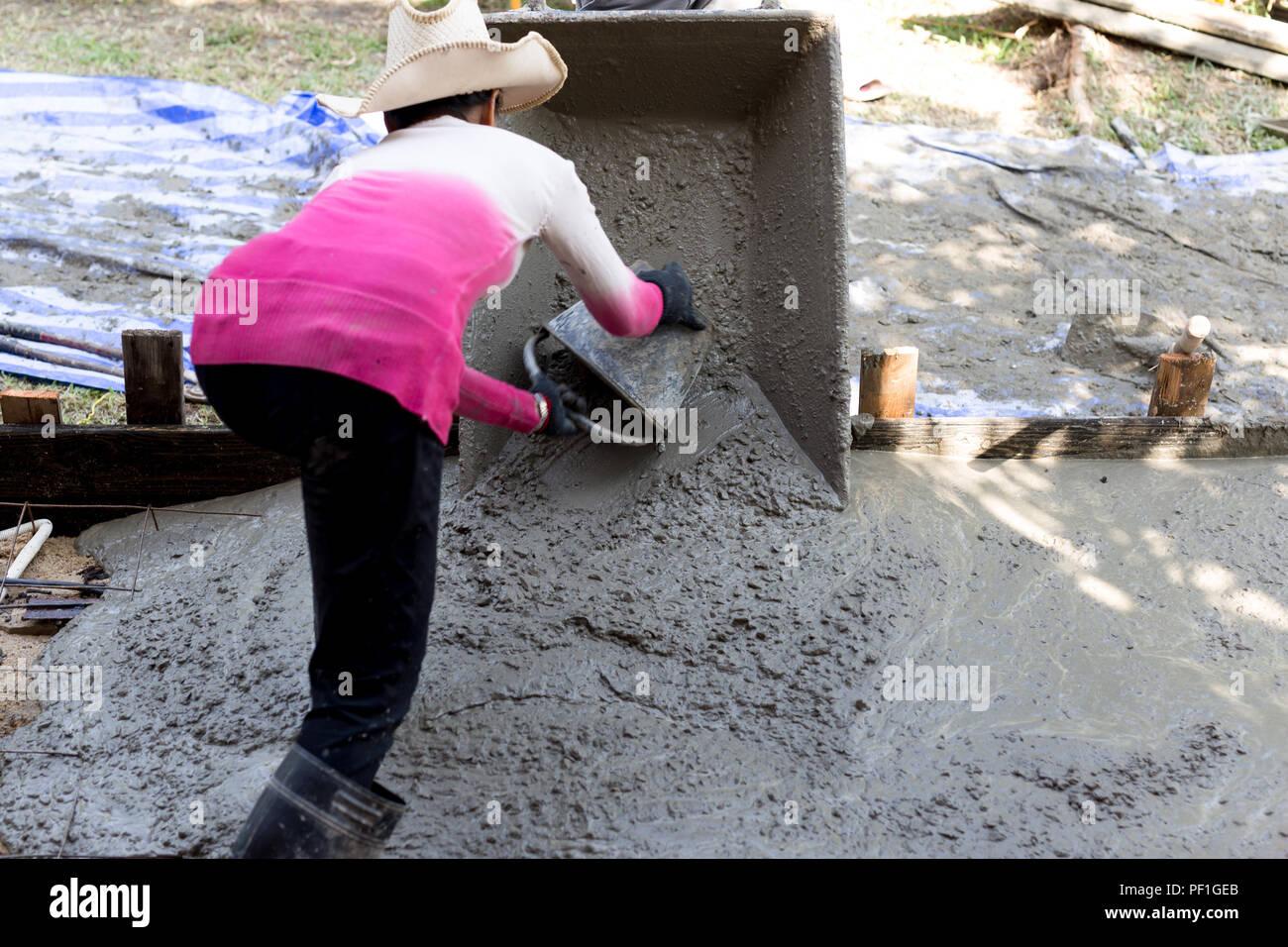 Woman construction worker poured concrete floors Stock Photo