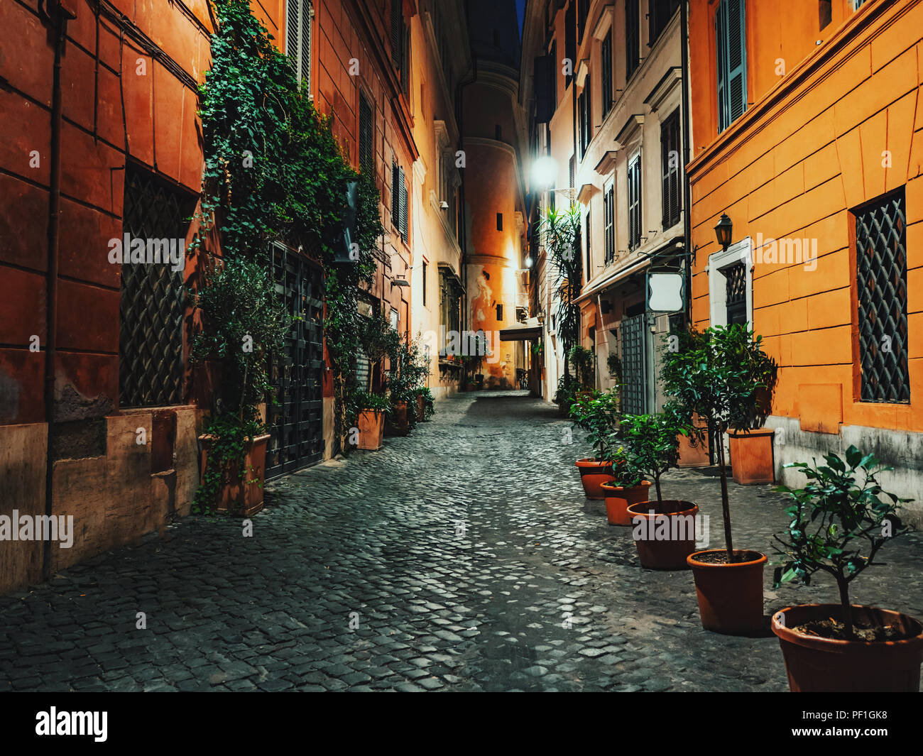 Evening or night view of old cozy street in Rome, Italy. Cityscape of italian capital with nobody. Stock Photo