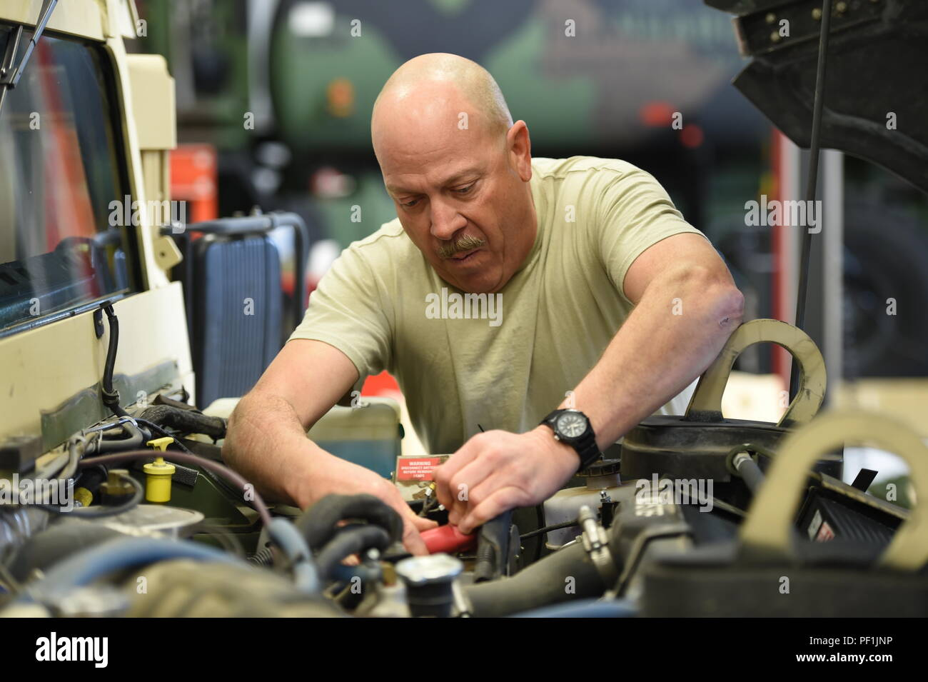 Wiring Harness Stock Photos Images Alamy Car Repair Sgt 1st Class Kevin Read Checks A On Humvee At The Field