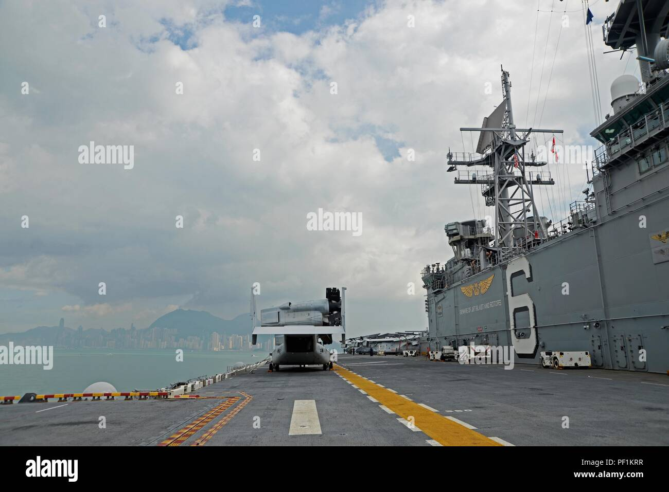 161002-N-YG104-004 HONG KONG (Oct. 02, 2016) The amphibious assault ship USS Bonhomme Richard (LHD 6) departs the harbor of Hong Kong after a scheduled port visit. Bonhomme Richard Expeditionary Strike Group, with embarked 31st MEU, was in Hong Kong to experience the city's rich culture and history as part of their multi-month patrol in the region. Stock Photo