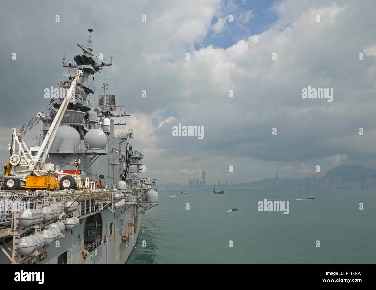 161002-N-YG104-001 HONG KONG (Oct. 02, 2016) The amphibious assault ship USS Bonhomme Richard (LHD 6) departs the harbor of Hong Kong after a scheduled port visit. Bonhomme Richard Expeditionary Strike Group, with embarked 31st MEU, was in Hong Kong to experience the city's rich culture and history as part of their multi-month patrol in the region. Stock Photo