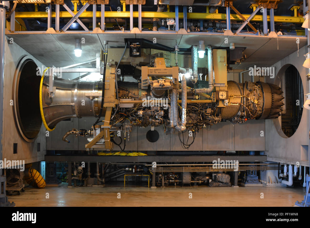 An F135-PW-100 engine, which powers the F-35 Joint Strike Fighter, undergoes salt water corrosion testing in the Arnold Engineering Development Complex SL-3 facility at Arnold Air Force Base, Tenn., on Oct 23, 2016. (U.S. Air Force Photo/Christopher D. Rogers) - Stock Image