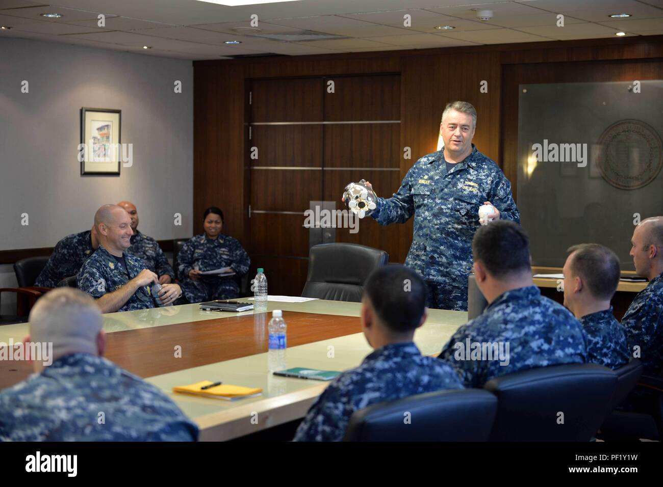 SINGAPORE (Feb. 24, 2016) - Capt. Scott Murdock, commanding officer, Navy Region Center Singapore (NRCS), discusses the importance of saving for the future with Sailors assigned to NRCS, Feb. 24, 2016. Murdock's advice to the Sailors was to 'start small and think big.' This year, across the fleet, Military Saves Week is observed with the goal of this year's campaign to increase awareness about the necessity to build wealth, reduce debt and to demonstrate user-friendly methods for people to make a commitment to save. - Stock Image