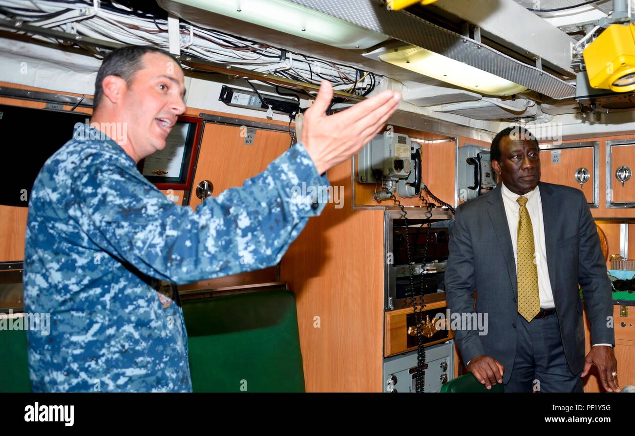 160219-N-EF781-010   JOINT BASE PEARL HARBOR-HICKAM, Hawaii (Feb. 16, 2016)  Ray Shepherd (right), Director of Defense Media Activity for the Department of Defense, recently toured the Los Angeles-class fast-attack submarine, USS Greeneville (SSN 772) at Pearl Harbor. Cmdr. Gabriel Anseeuw (left), commanding officer of USS Greeneville, led Shepherd and a group of DMA officials on a tour highlighting the capabilities of America's nuclear-powered submarine force. Shepherd's role is to provide a direct line of communication for news and information to U.S. forces worldwide.  (U.S. Navy photo by L - Stock Image