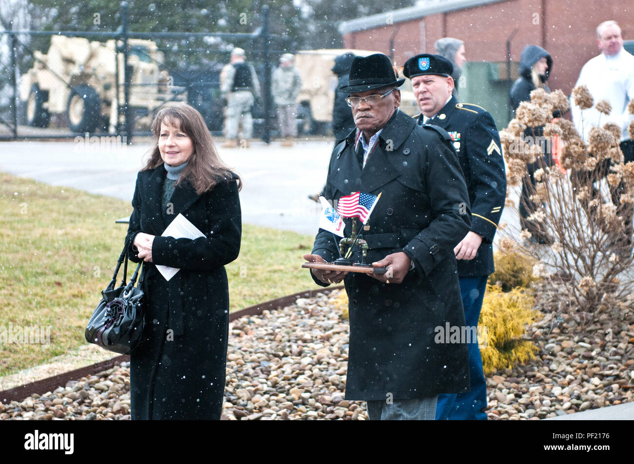 Family members of fallen Soldiers from the 14th Quartermaster Detachment, who died during a scud missile attack in Operation Desert Storm, walk toward the monument dedicated to the 14th QM Detachment in Greensburg, Pa., Feb. 25, 2016. (U.S. Army photo by Staff Sgt. Dalton Smith/Released) - Stock Image