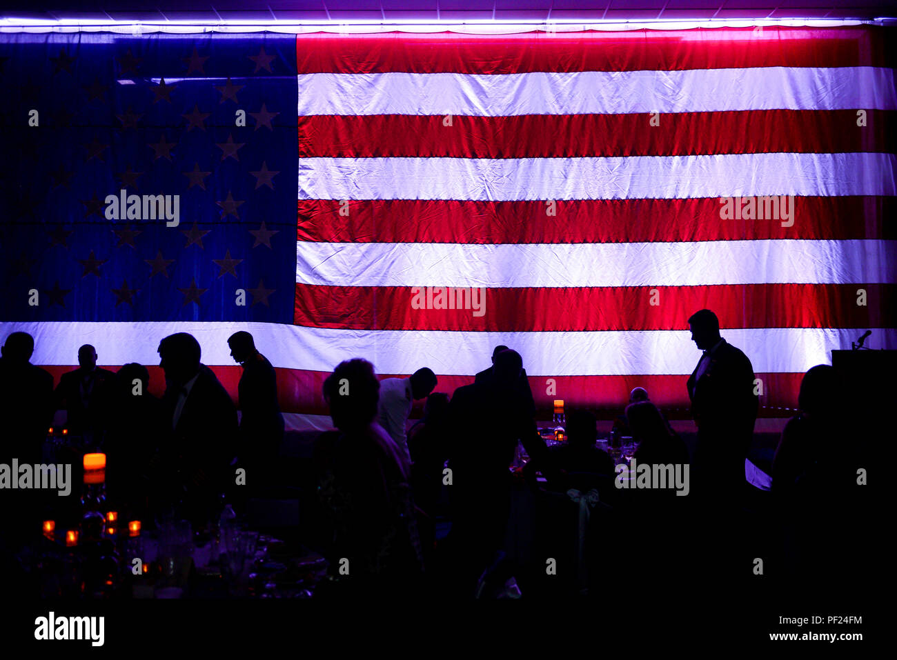 Service members at U.S. Naval Station Guantanamo Bay and Joint Task Force Guantanamo gather at the decorated Windjammer Ballroom for the 240th Marine Corps Birthday Ball. Stock Photo