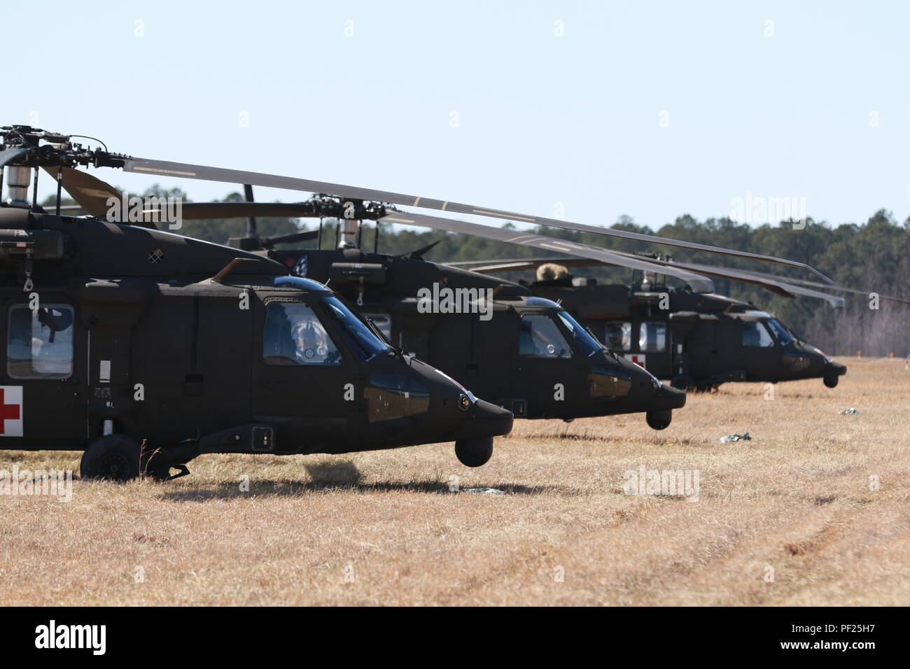 UH-60s assigned to Charlie Company, 3rd General Support Aviation Battalion, 82nd Combat Aviation Brigade, sit waiting for their next mission, Fort Pickett, Va., Feb. 29. The helicopters provided aerial medical evacuation support to no only the CAB, but to 5th Squadron, 73rd Cavalry Regiment, 3rd Brigade Combat Team, allowing their combat medics the chance to practice resuce hoist operations. (U.S. Army photo by Staff Sgt. Christopher Freeman/ 82nd CAB PAO) - Stock Image