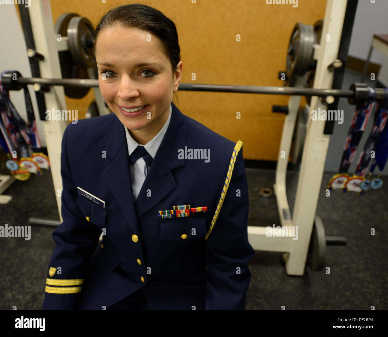 "Lt. Nyrel Allen, Coast Guard 13th District flag aide and Coast Guard elite female athlete of the year, sits with her powerlifting medals in the gym at the 13th district headquarters in Seattle, Dec. 15, 2015. Allen is also a Lead Facilitator for an anti-bullying workshop titled ""Power up,"" focused on helping young women from third to 12th grade understand the negative impacts of bullying. (U.S. Coast Guard photo by Petty Officer 3rd Class Amanda Norcross) - Stock Image"