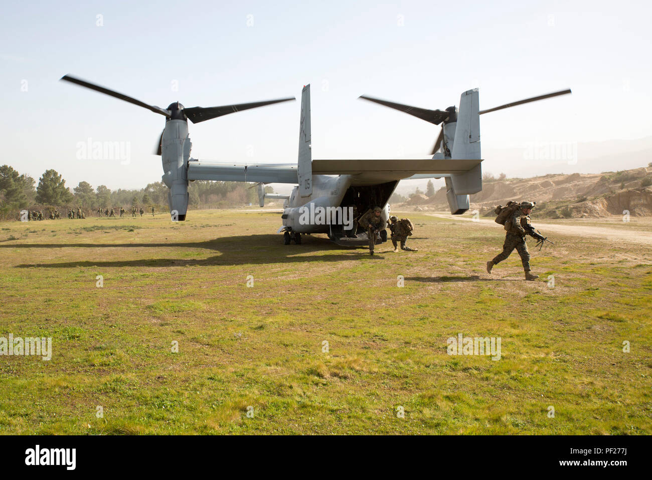 U.S. Marines and the Portuguese Fuzileros disembark from MV-22B Ospreys during an airfield seizure exercise as part of Operation Real Thaw in Seia, Portugal, Feb. 22, 2016. Marines with Special-Purpose Marine Air-Ground Task Force Crisis Response- Africa are continuously conducting bilateral training with partner nations to sustain and improve core mission essential tasks and build interoperability to prepare for real world operations on the African continent. (U.S. Marine Corps photo by Sgt. Tia Nagle) - Stock Image