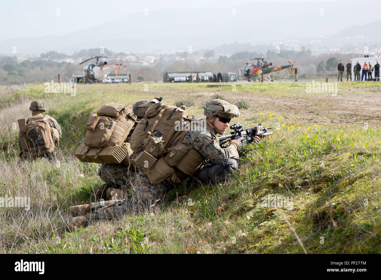 U.S. Marines with Special-Purpose Marine Air-Ground Task Force Crisis Response- Africa set up security during an airfield seizure exercise conducted alongside the Portuguese Marines as part of Operation Real Thaw in Seia, Portugal, Feb. 22, 2016. Marines with SPMAGTF-CR-AF are continuously conducting bilateral training with partner nations to sustain and improve core mission essential tasks and build interoperability to prepare for real world operations on the African continent. (U.S. Marine Corps photo by Sgt. Tia Nagle) - Stock Image