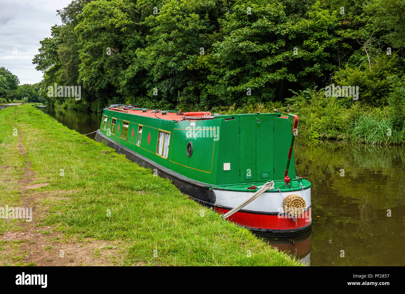 The Staffordshire and Worcestershire Canal near Penkridge Staffordshire with a Narrowboat moored up. Stock Photo