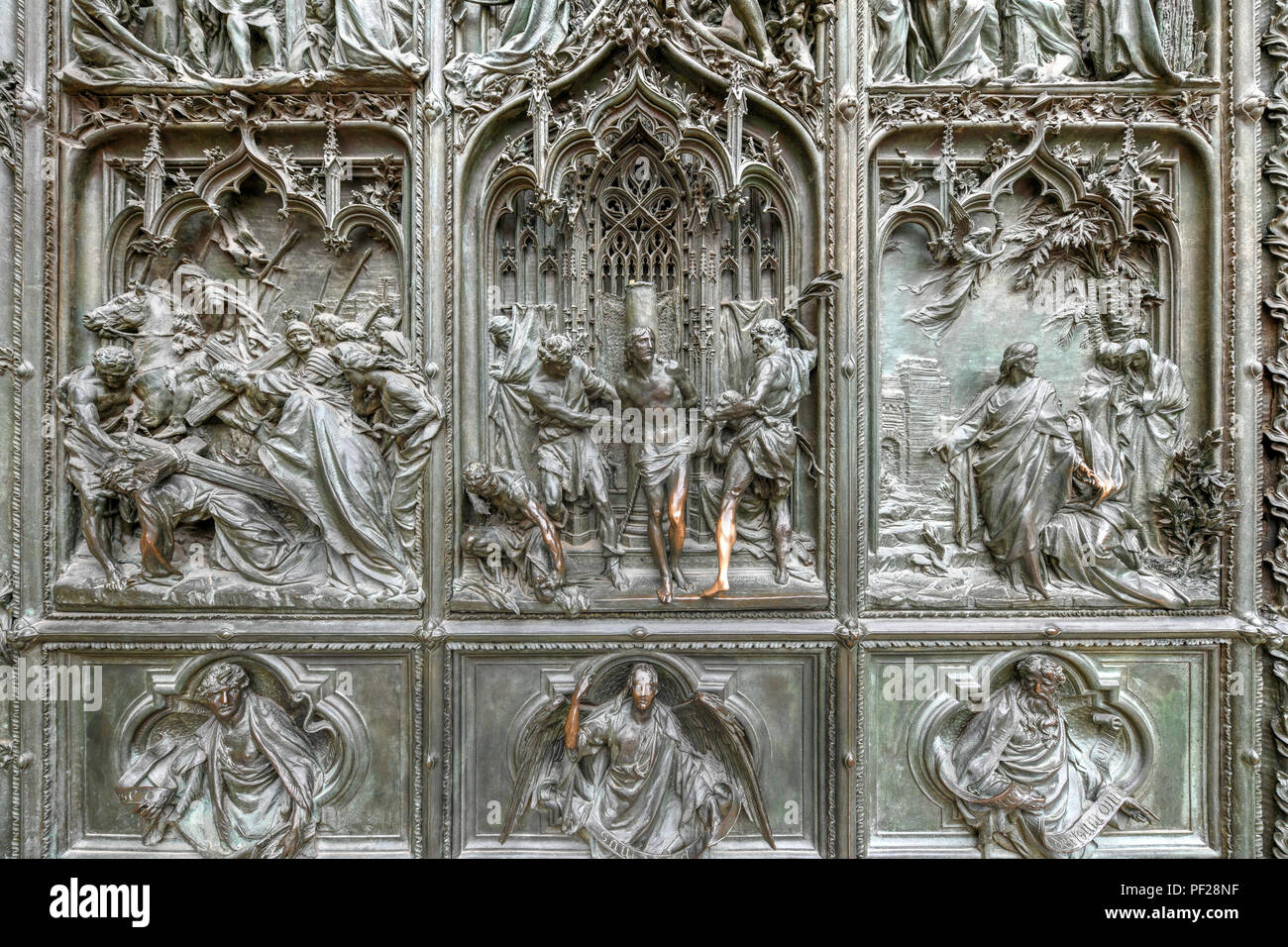 Door of the Milan Cathedral, Cathedral of the Nativity of the Virgin Mary - Cathedral in Milan, is located in the historic center of the city and is i - Stock Image