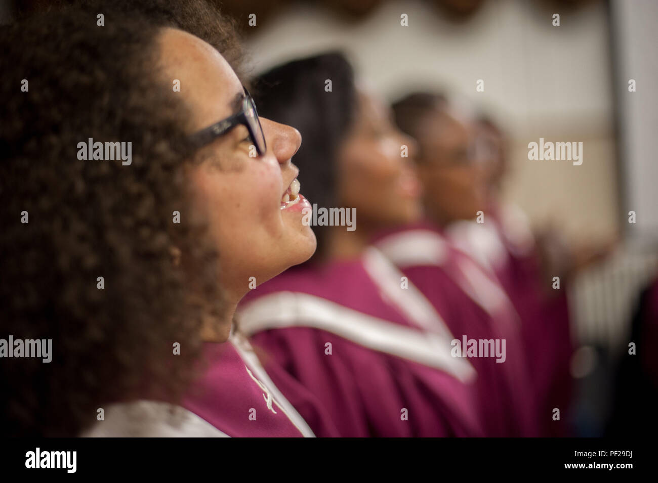 Tracy Naveau, a member of the Voices of Victory choir sings