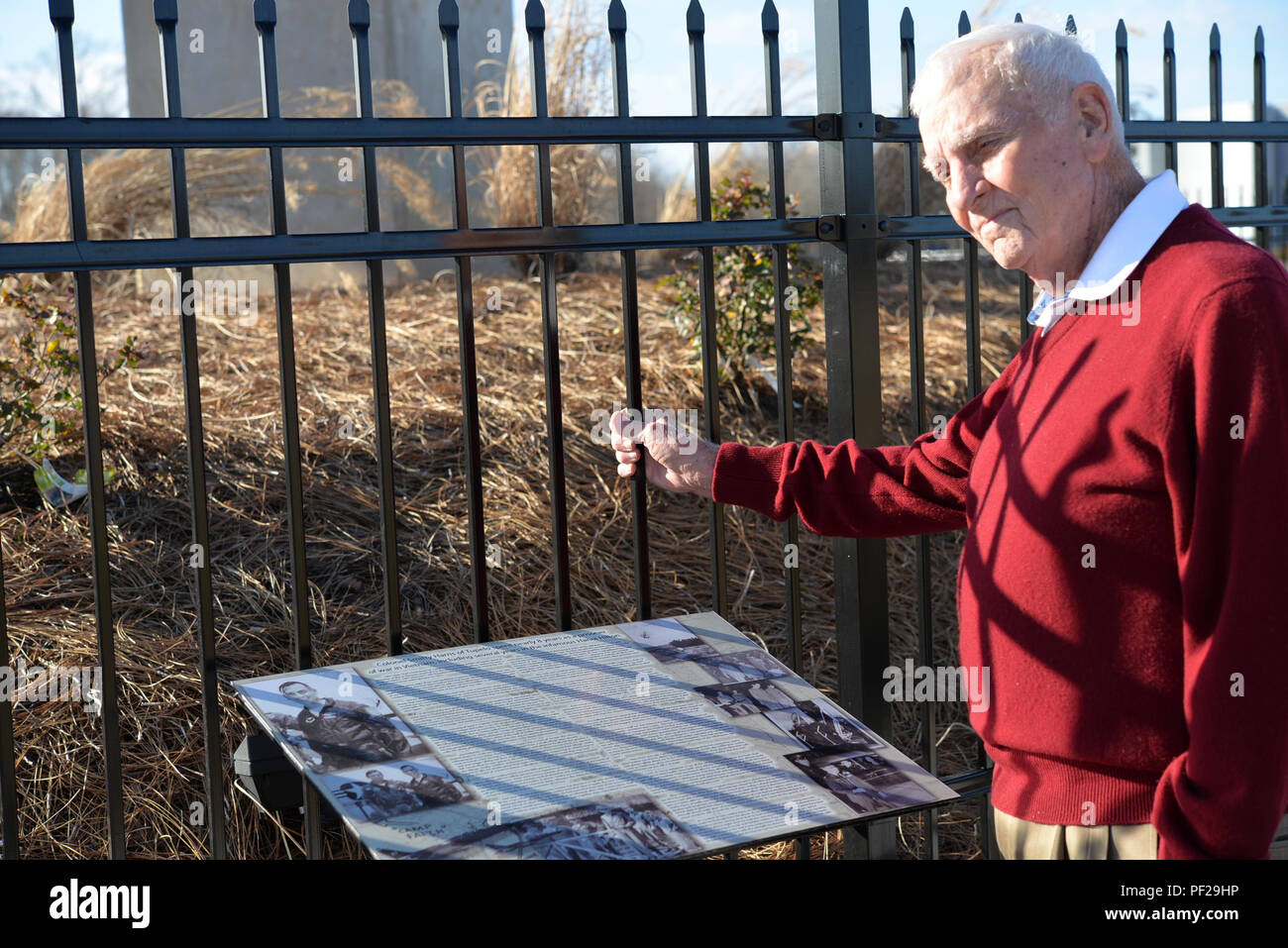 Col. Carlyle Harris reflects on his experience as a prisoner of war in Vietnam at a monument Feb. 3, 2016, outside Tupelo, MS where his story is portrayed on a plaque near an F-105 Thunderchief like the one he was shot down in on Apr. 4, 1965.  Harris was held for more than eight years while his wife raised their three children alone in the U.S. - Stock Image