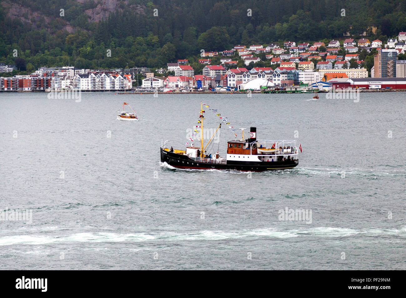 Veteran passenger steamship Granvin (built 1931) sailing from the port of Bergen, Norway to Byfjorden on a grey and rainful day. Fjordsteam 2018,. - Stock Image