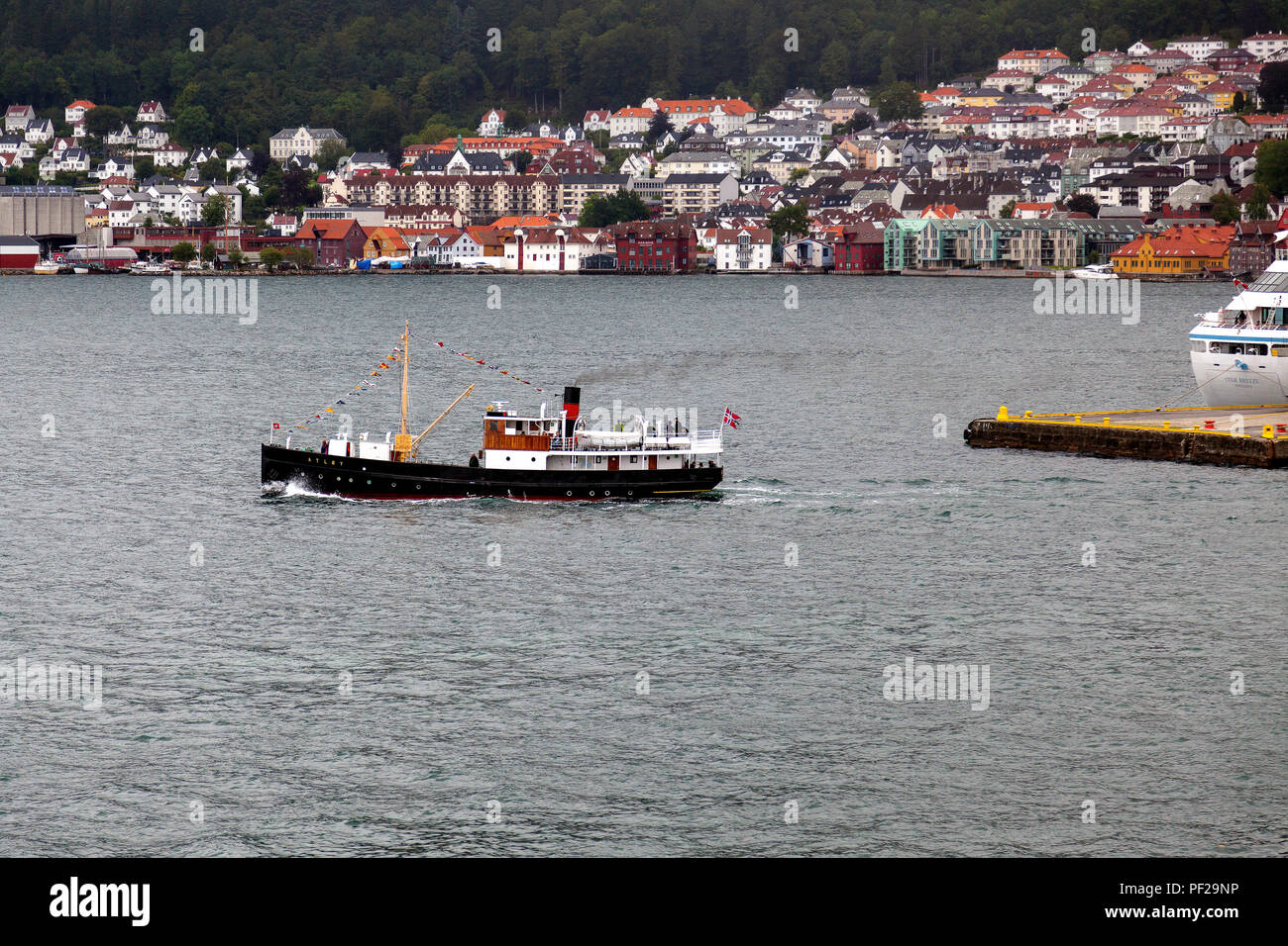 Veteran passenger steamship Atloy (built 1931) sailing from the port of Bergen, Norway to Byfjorden on a grey and rainful day. Fjordsteam 2018,. - Stock Image