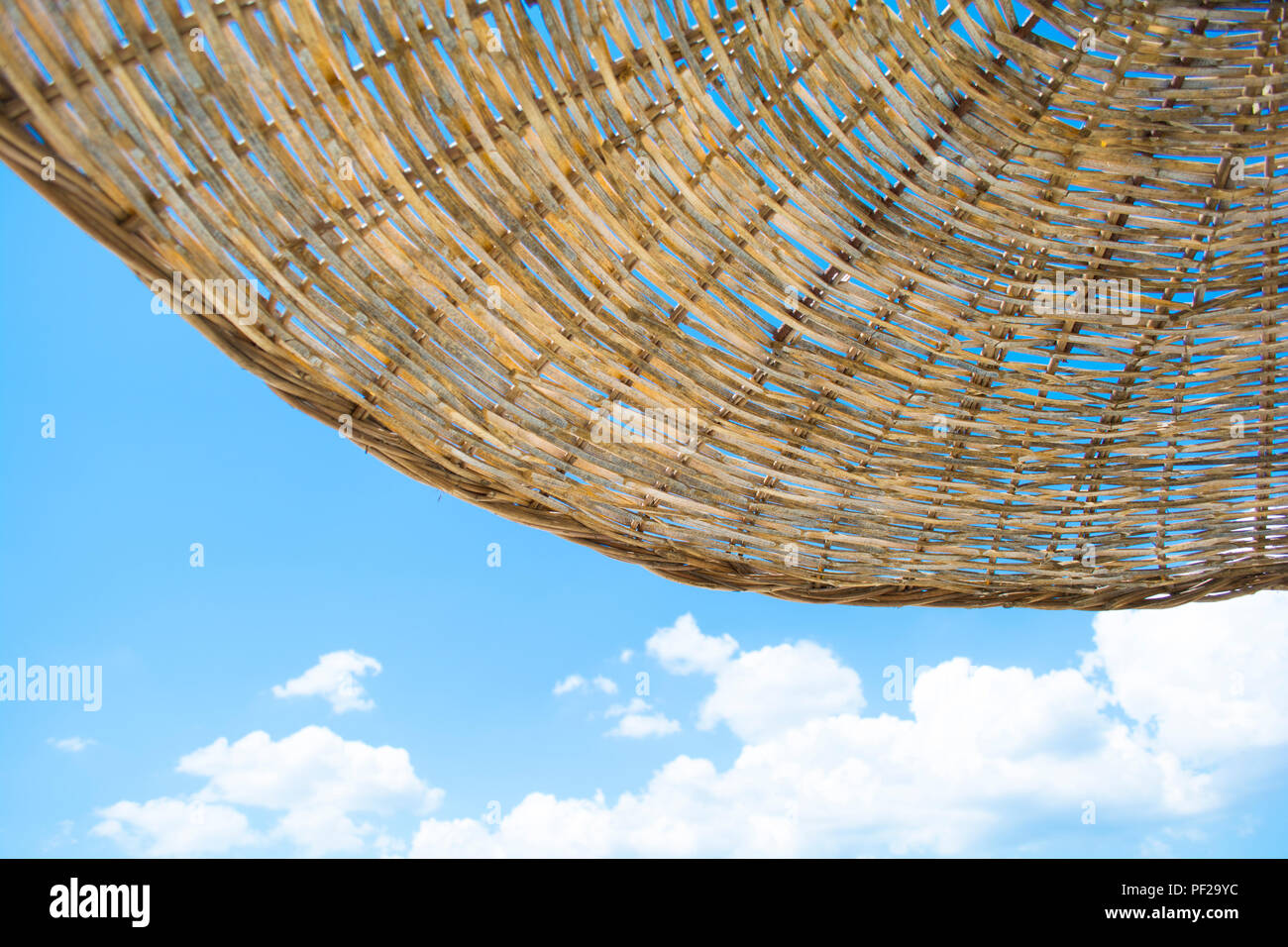 Beach Straw Umbrella with Clear Blue Sky on Sunny Summer Day. Beach Umbrella Wallpaper Background. - Stock Image