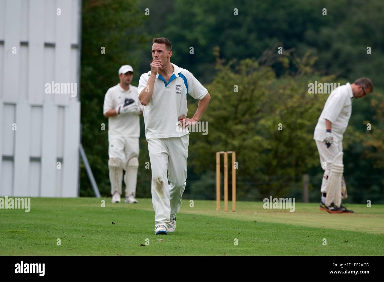A bowler prepares himself mentally before bowling in a match between Chalesworth and Chisworth second eleven and Pott Shrigley second eleven. - Stock Image