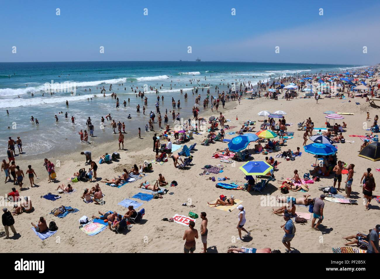 crowded beach during a heat wave in Huntington Beach California - Stock Image