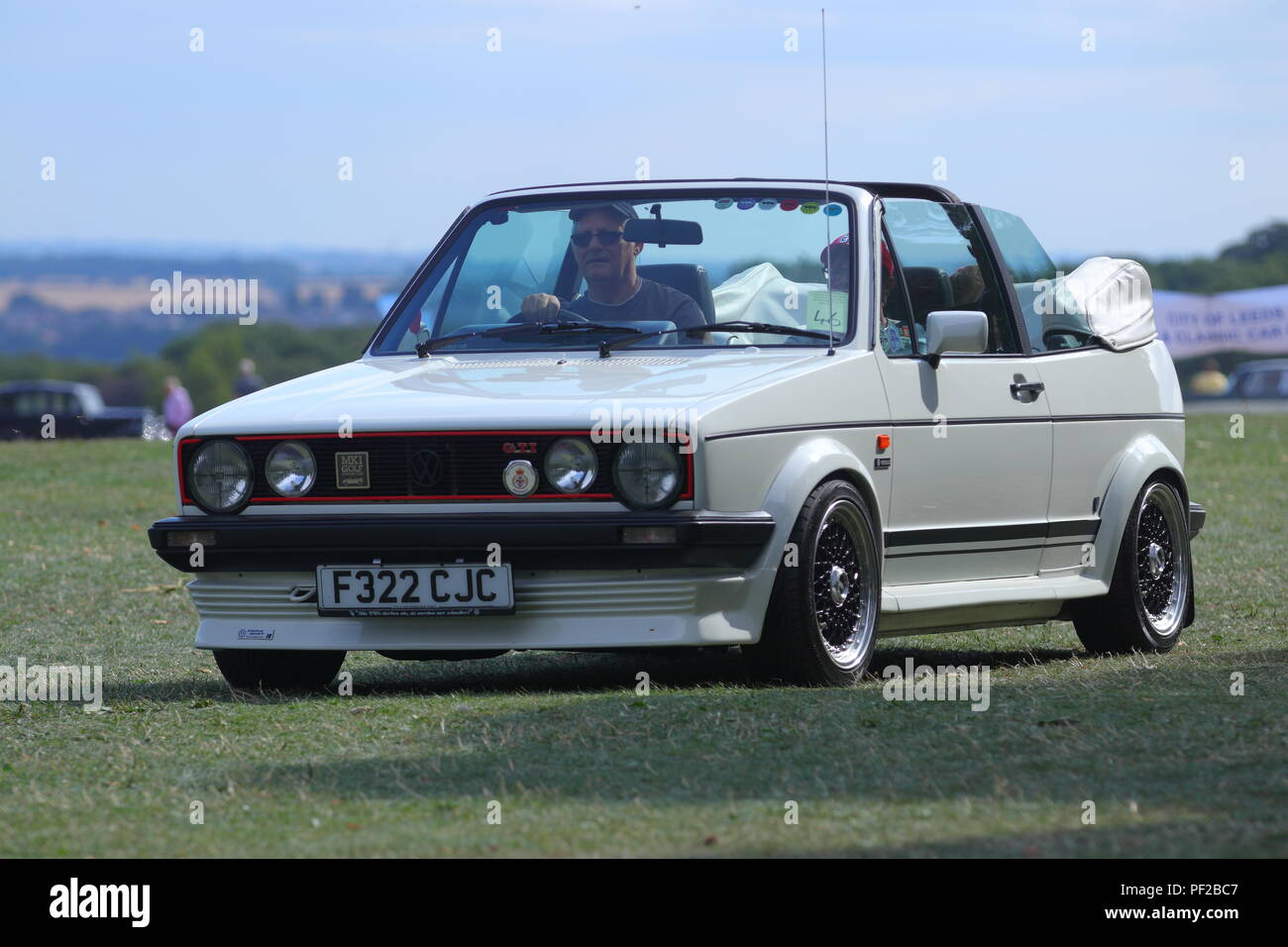 A 1988 Volkswagen Golf GTI MK1 in White , leaving a Classic Car Show at Temple Newsam in Leeds - Stock Image