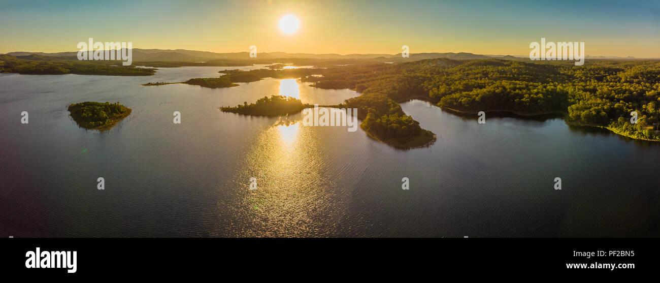 Aerial panoramic image of Sansonvale lake during sunset, Brisbane, Australia - Stock Image