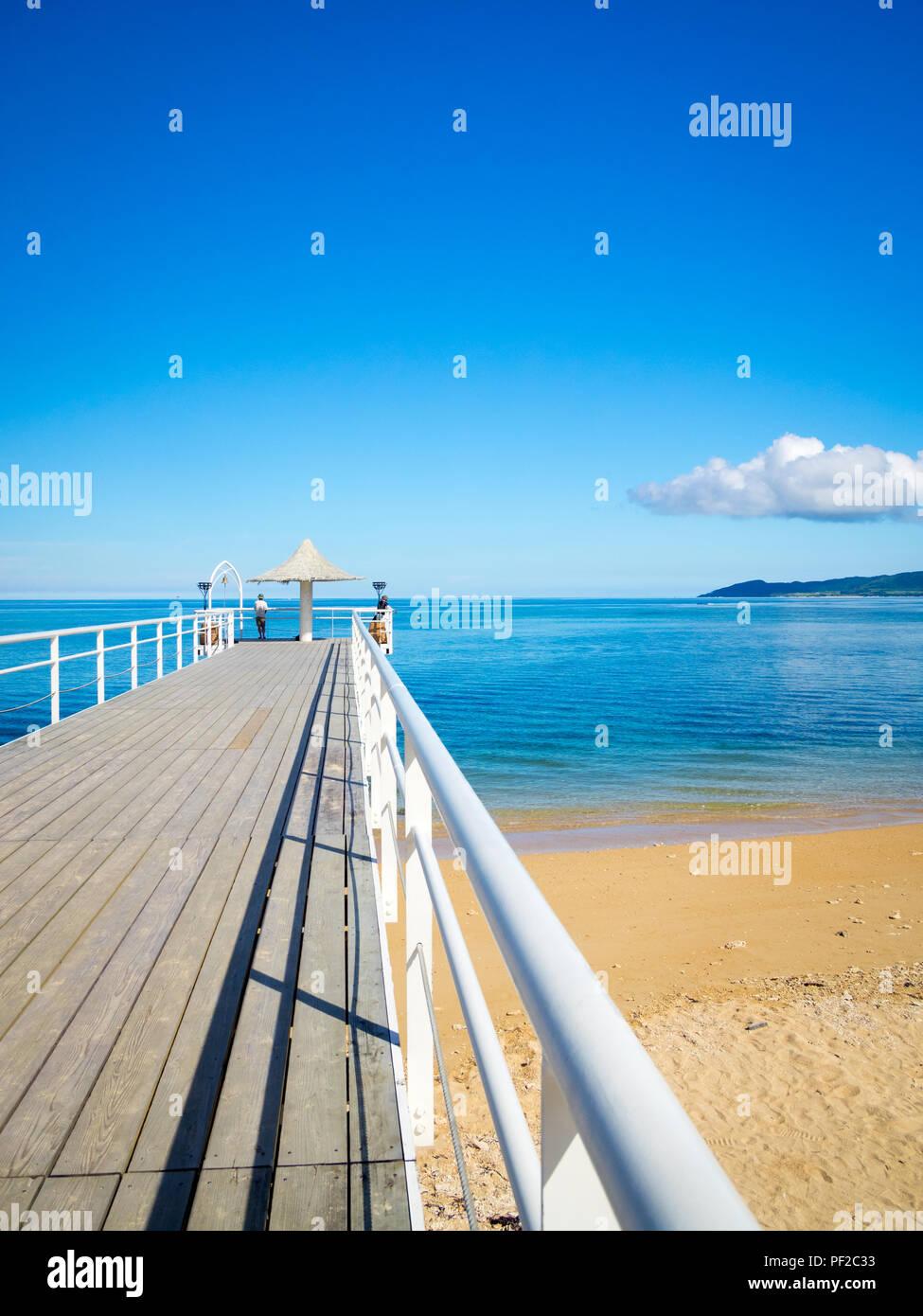 A view of Fusaki Angel Pier and Fusaki Beach on the southwest coast of Ishigaki Island (Ishigaki-jima), Okinawa Prefecture, Yaeyama Islands, Japan. - Stock Image