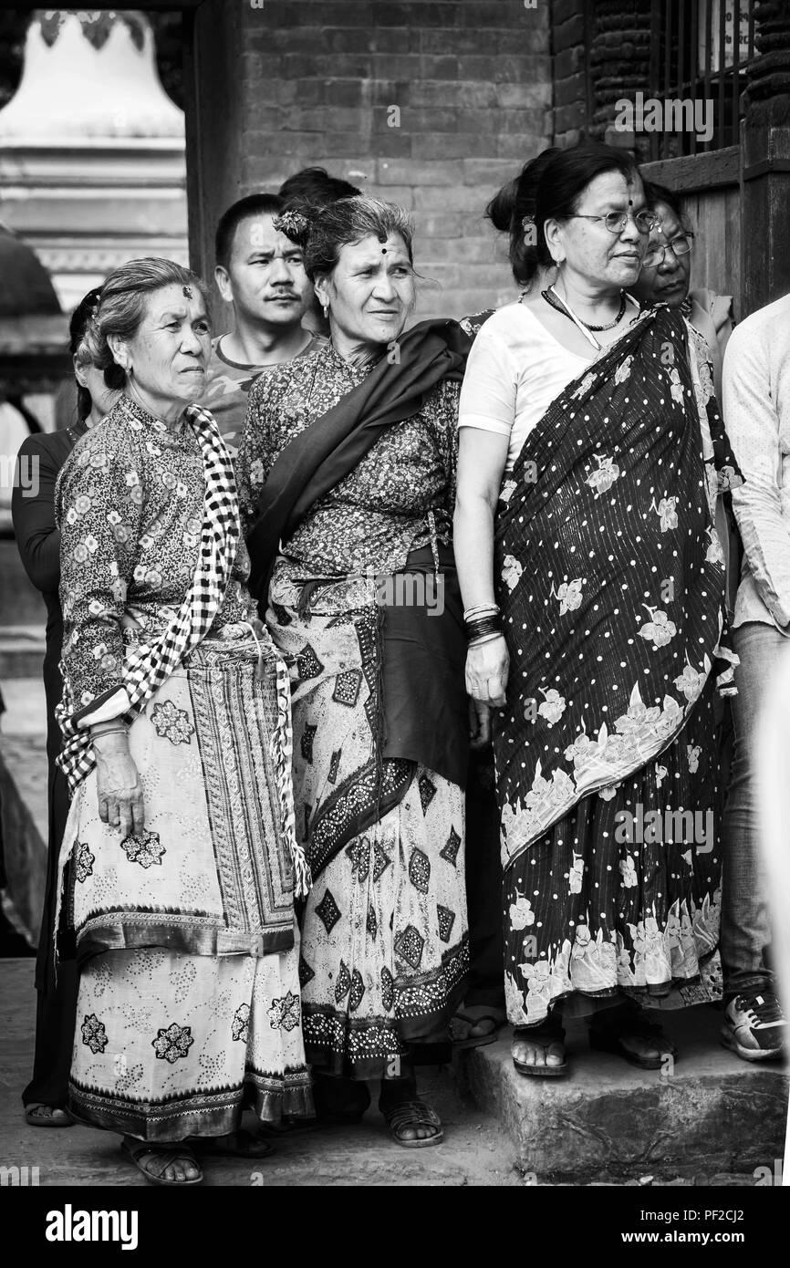 kathmandu,Nepal - Aug 17,2018: Hindu Nepali women with traditional attire watching festival celebrated in kritipur Kathmandu Nepal.Black and white ima - Stock Image