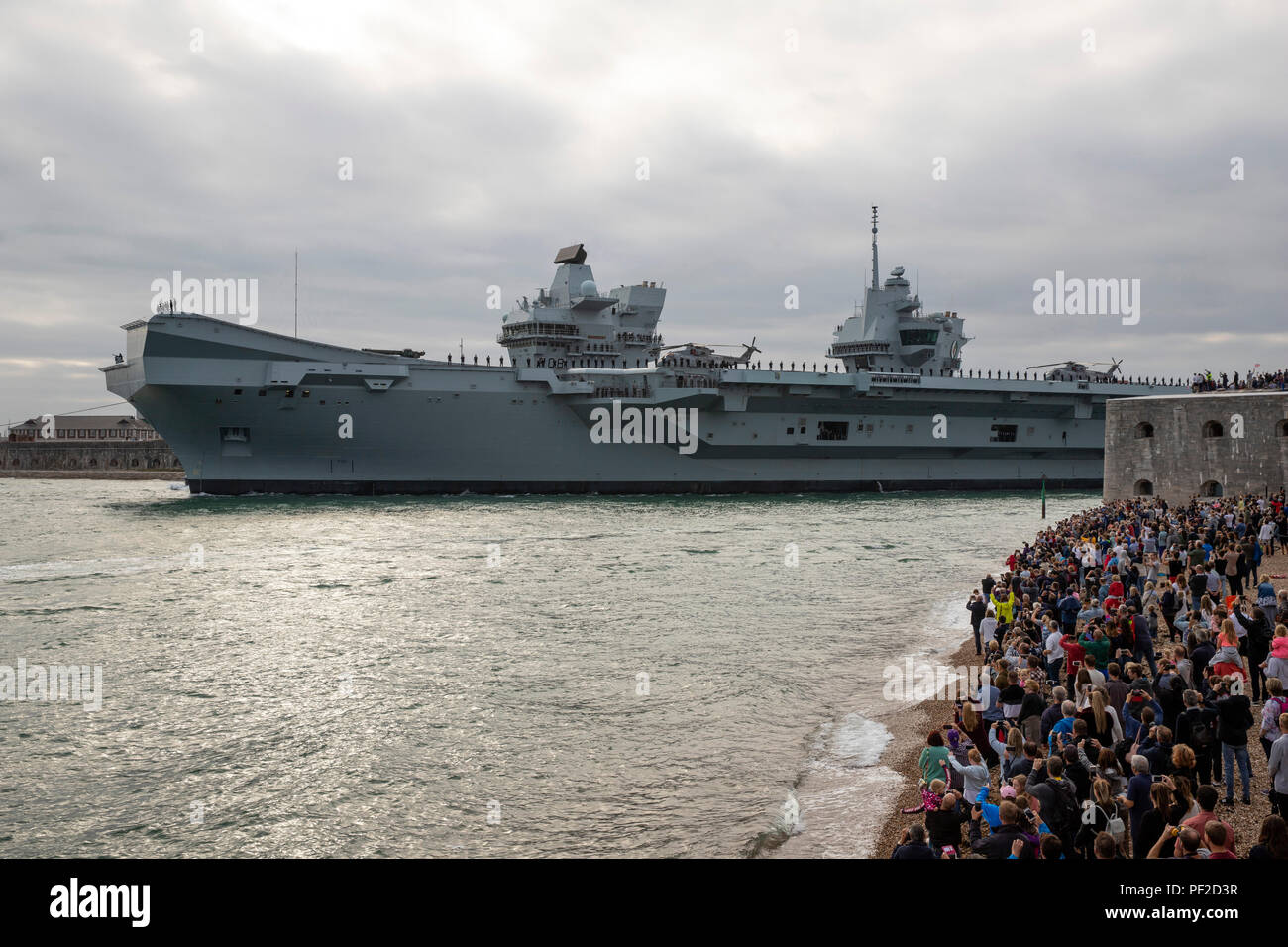 18 August 2018 Portsmouth, Hampshire UK Royal Navy Flagship HMS Queen Elizabeth leaving Portsmouth for her latest sea trials - Stock Image