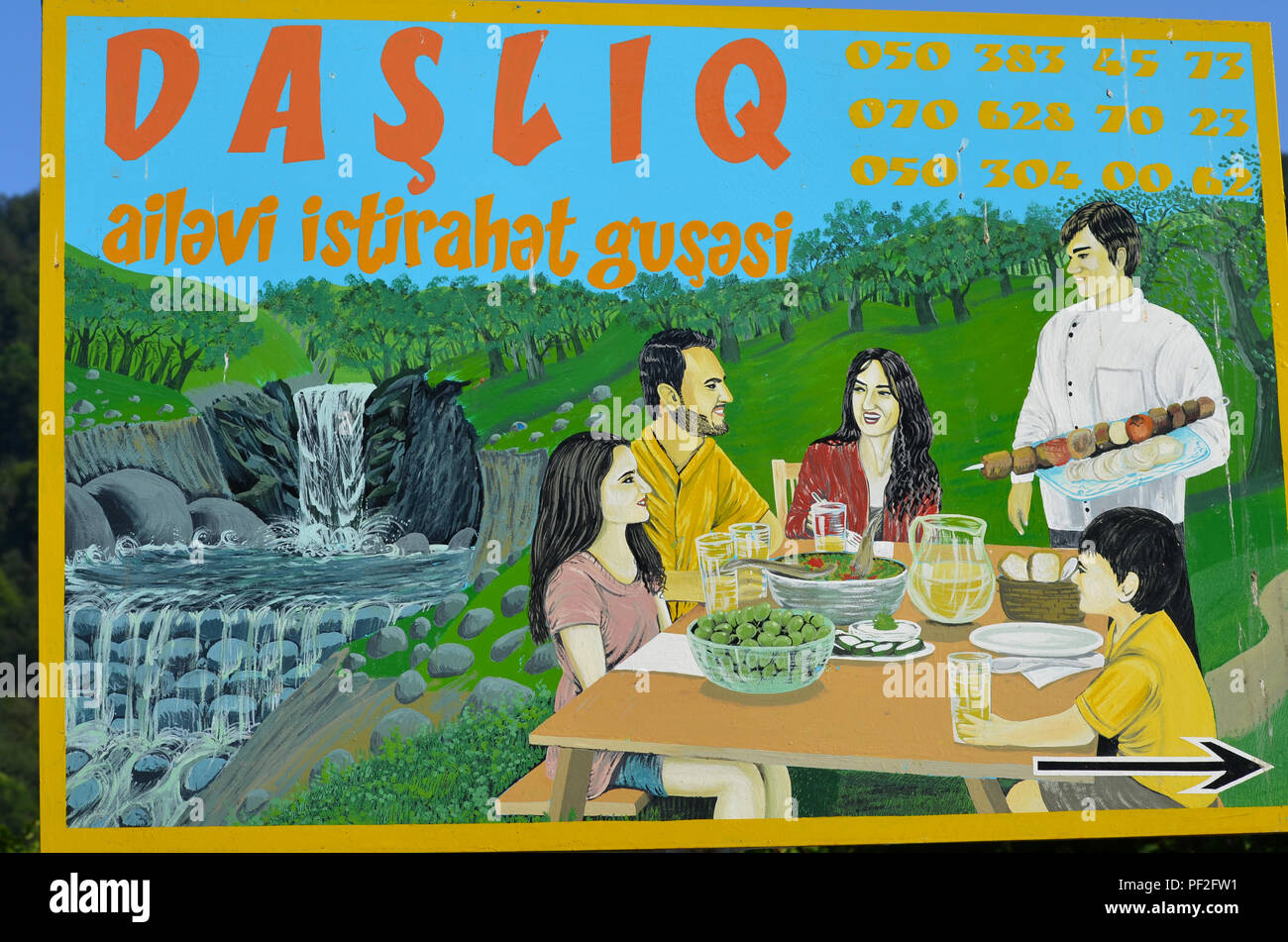 Restaurant billboard aimed at local visitors near Zaqatala, northwestern Azerbaijan - Stock Image