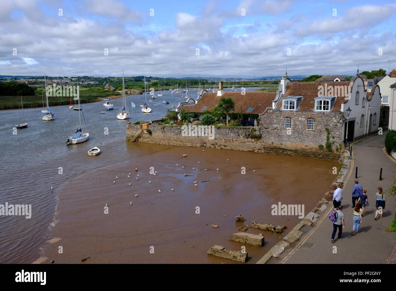 Topsham, Devon, UK. Tourists walk along the River Exe estuary in Topsham Stock Photo
