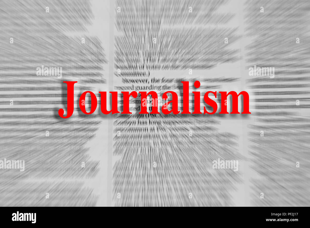 Journalism written in red with a newspaper article blurred in the background Stock Photo