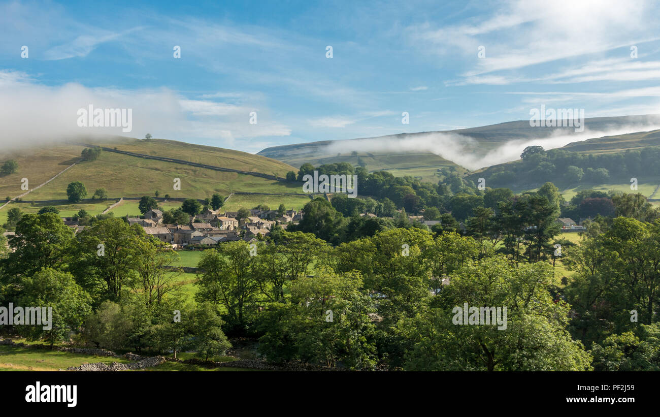 UK weather: Picturesque Kettlewell nestled in Wharfedale at 9am as the cloud inversion burns off in the building heat of the 2018 heatwave. Yorkshire  - Stock Image