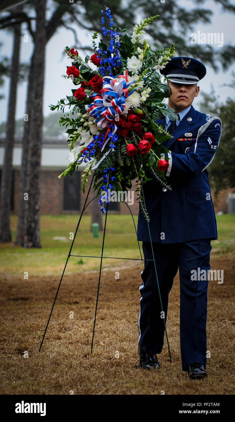 Hurlburt Field Base Honor Guard member carries a wreath during a remembrance ceremony for Spirit 03 at Hurlburt Field, Fla., Feb. 2, 2016. Two days after the 25th anniversary, Air Commandos, friends and families gathered at the Air Park to honor the crew of the AC-130H Spectre gunship, shot down on the morning of Jan. 31, 1991, during the Battle of Khafji. (U.S. Air Force photo by Senior Airman Meagan Schutter) - Stock Image