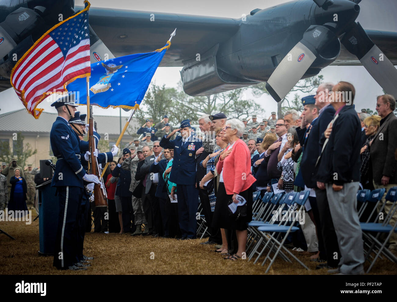 Hurlburt Field Base Honor Guard members present the colors before the AC-130H Spectre dedication ceremony at Hurlburt Field, Fla., Feb. 2, 2016. The Spectre played a role in operations all over the world, first in Vietnam, proceeding into the latter of the 20th century with operations Eagle Claw, Urgent Fury, Just Cause and Desert Storm. The last operational years of the AC-130H Spectre were spent flying combat missions in the Balkans and Somalia, and in Afghanistan in support of Operation Enduring Freedom. (U.S. Air Force photo by Senior Airman Meagan Schutter) - Stock Image