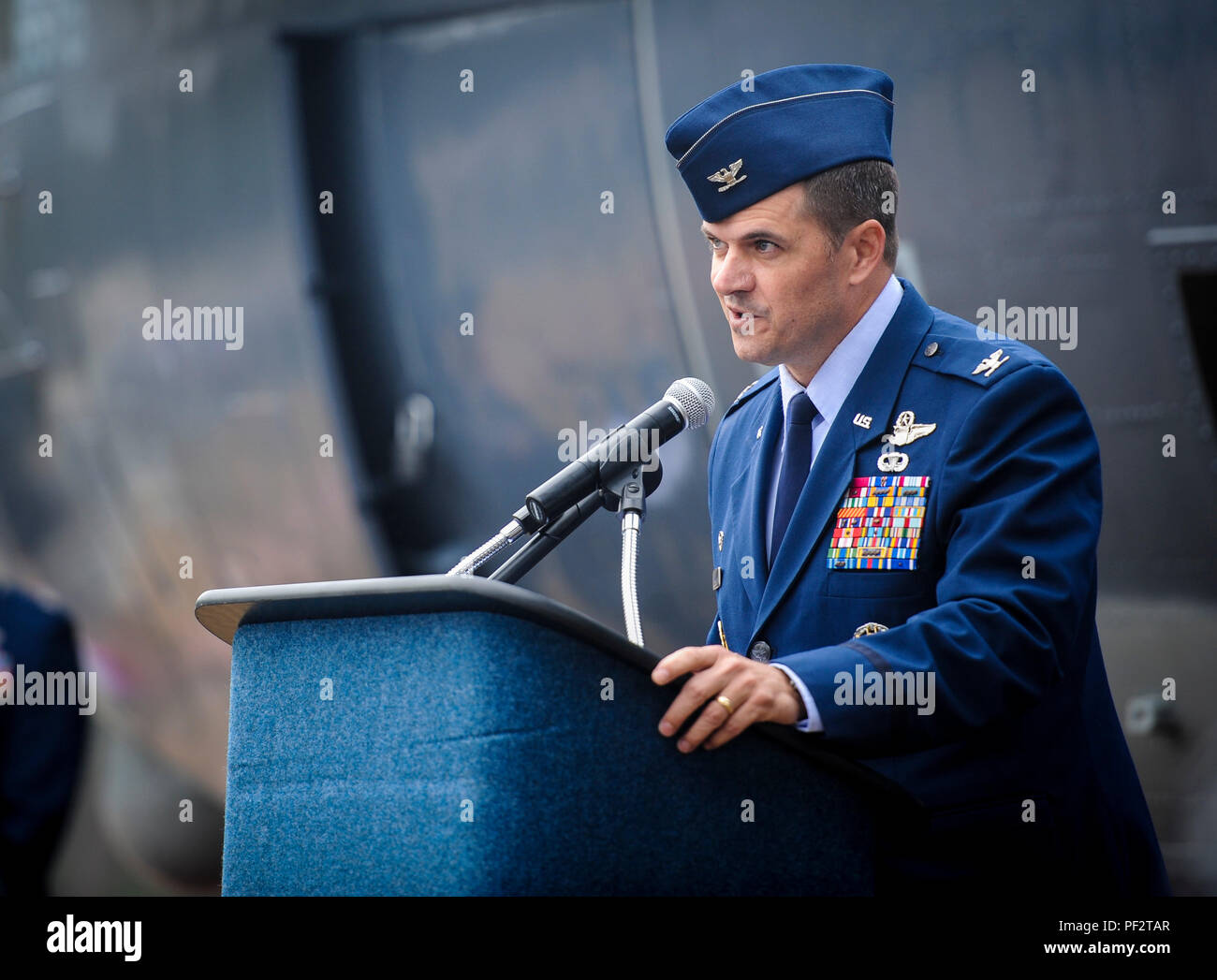 Col. Sean Farrell, commander of the 1st Special Operations Wing, speaks to guests during the AC-130H Spectre dedication ceremony at Hurlburt Field, Fla., Jan. 2, 2016. The Spectre played a role in operations all over the world, first in Vietnam, proceeding into the latter of the 20th century with operations Eagle Claw, Urgent Fury, Just Cause and Desert Storm. The last operational years of the AC-130H Spectre were spent flying combat missions in the Balkans and Somalia, and in Afghanistan in support of Operation Enduring Freedom. (U.S. Air Force photo by Senior Airman Meagan Schutter) - Stock Image