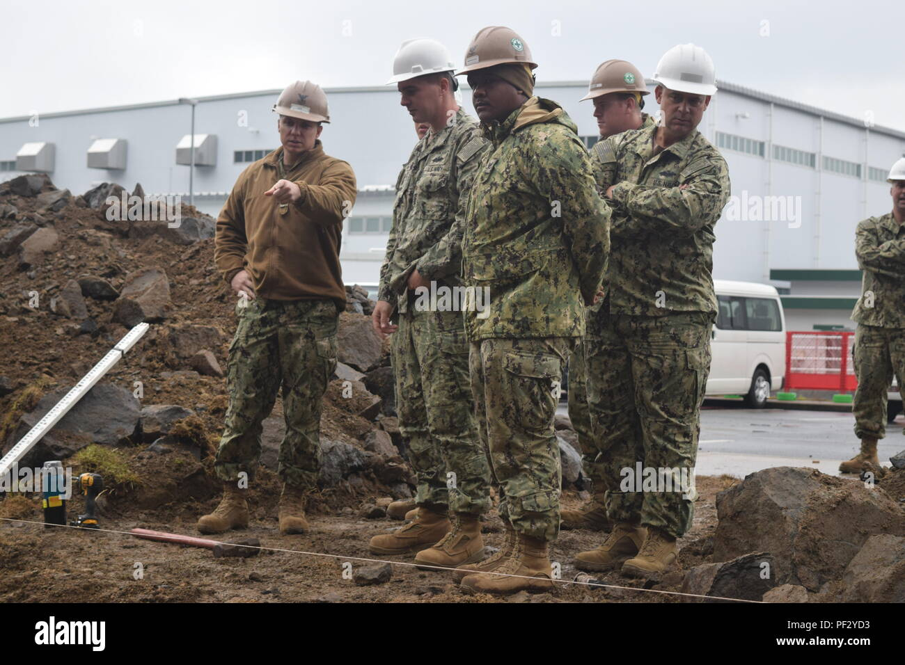 SASEBO, Japan (Dec. 6, 2017) Seabees from 30th Naval Construction Regiment visits Naval Mobile Construction Battalion (NMCB) 4 in Sasebo, Japan to check on the progress of the project and to inspect the Pre-Engineered Building (PEB). NMCB 4 is forward deployed to the pacific, ready to support major combat operations, humanitarian assistance/disaster relief operations, and provide general engineering support to Navy, Marine Corps, and joint operational forces.  (U.S. Navy photo by Builder 3rd Class Thomas Dykes/RELEASED) - Stock Image